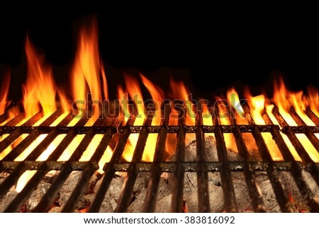 Empty Barbecue Flaming Charcoal Grill With Bright Flames Of Fire Isolated On The Black Background, Close-up, Copy Space, Top View. Concept For Outdoor Party Or Picnic - stock photo