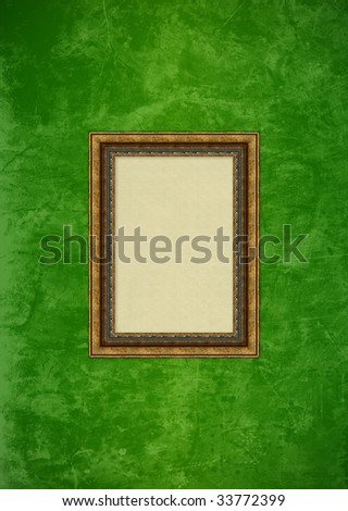Empty baroque picture frame with copyspace on a green grunge stucco wall - stock photo