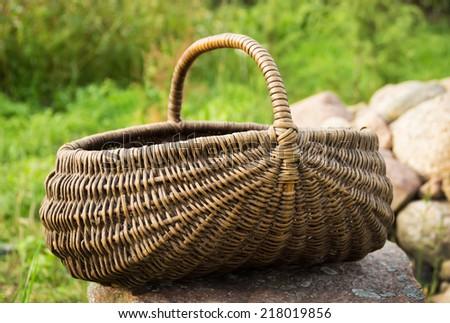 Empty basket / Braided basket basket on green lawn  - stock photo