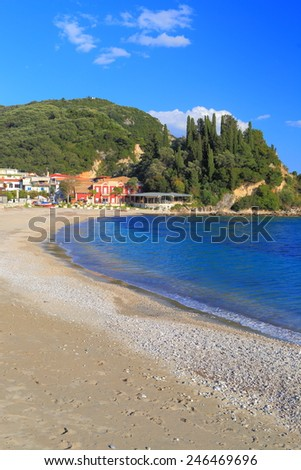 Empty beach and calm waters of the Ioanian sea in Parga, Greece  - stock photo