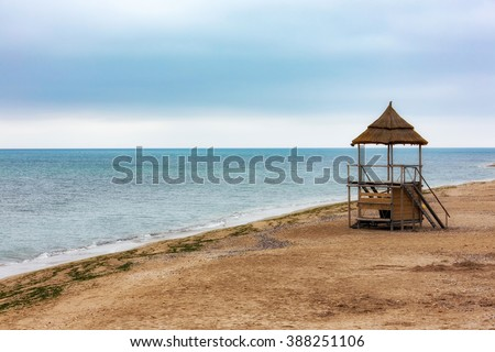 Empty beach. Display texture and color on a sandy beach while photographed in early morning light. Black Sea. Mamaia. Constanta. Romania. soft focus. warm light. old rich colors. - stock photo