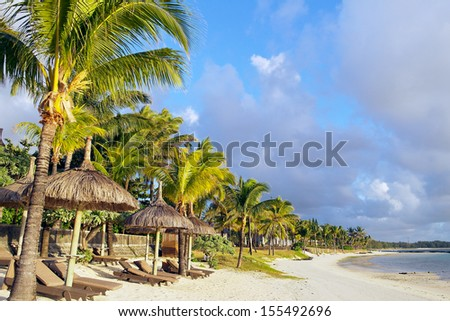 Empty beach in the early morning on Mauritius - stock photo