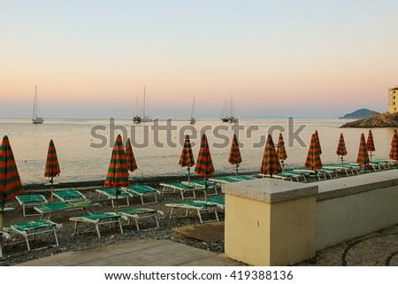 Empty beach on the coast of the Tyrrhenian Sea on the sunset. Elba Island, Italy - stock photo