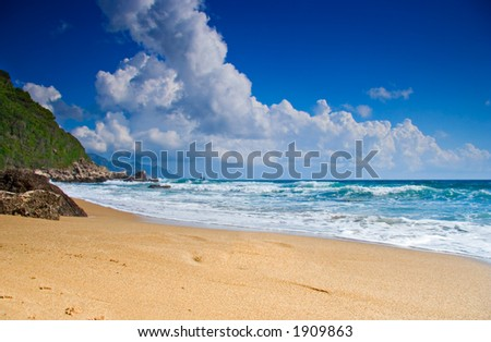 Empty beach with clouds in Greece - stock photo