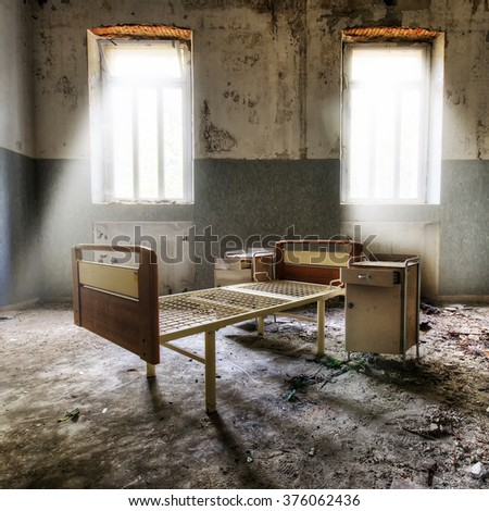 empty bed in a house to rubble in chernobyl