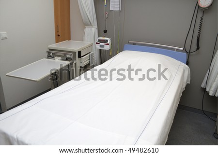Empty bed in hospital room.