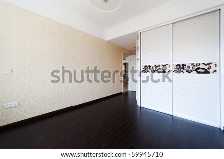 Empty bedroom with droplamp and cabinet after renovation - stock photo
