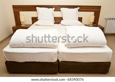 Empty beds in  a bedroom - stock photo