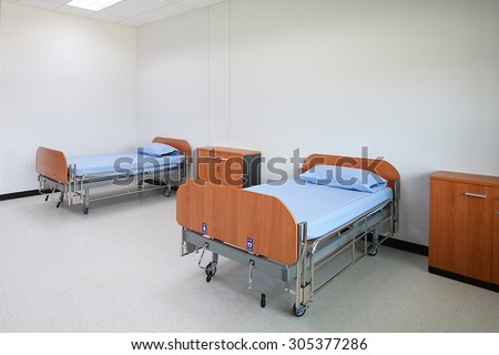 Empty beds in  the Patient room. - stock photo