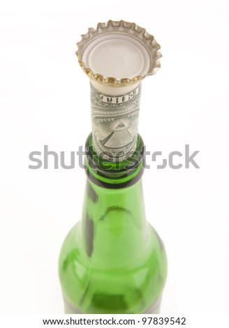 Empty beer bottle and money. Isolated on white background  concept of alcoholism spending money hoarding and tip - stock photo