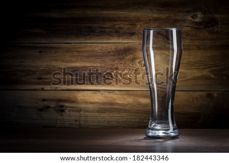 empty beer glass on a wooden background - stock photo