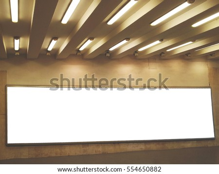 Empty billboard in city subway station