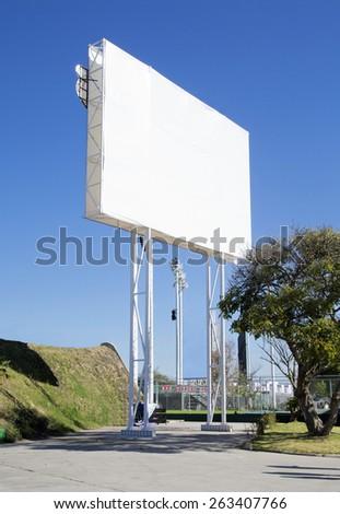 Empty billboard with blue sky. - stock photo