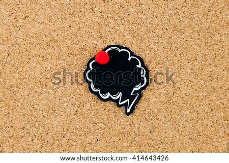 Empty black speech bubble pinned over cork board background, copy space available - stock photo