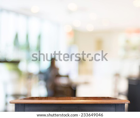 Empty Black vintage table top at coffee shop blurred background with bokeh light,Template mock up for display of your product. - stock photo