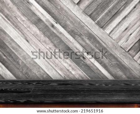Empty Black wood table at blurred pale plank wooden wall in  background,Template for display your product