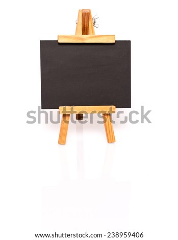 Empty blackboard with easel for your text. Photo on white with shadow and reflection - stock photo