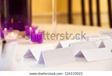 Empty blank card and copy-space for example guest names in restaurant - stock photo