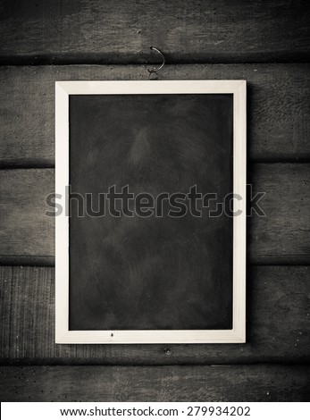 empty Blank chalkboard in wooden frame isolated on wooden background