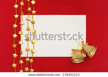 Empty  blank, two  christmas bells and garlands  on red background