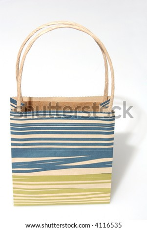 Empty blue and green striped paperbag isolated on white frontal view - stock photo
