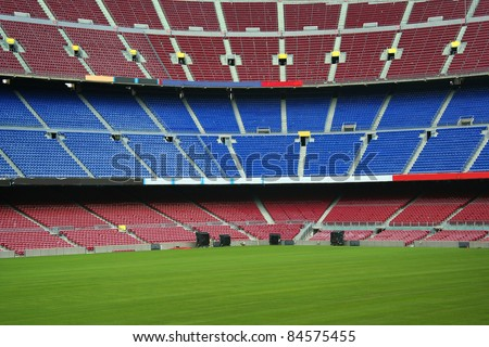 empty blue and red stadium seats - stock photo