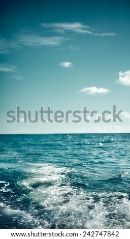 Empty Blue dark  fresh Ocean and Blue Sky with waves - stock photo