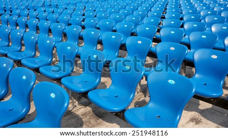 Empty Blue Numbered Plastic Chairs - stock photo