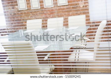 Empty boardroom through a window - stock photo