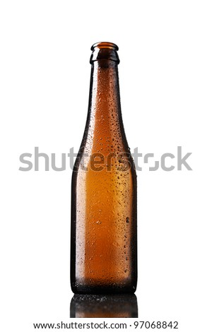 Empty bottle of beer with drops isolated on white background. - stock photo