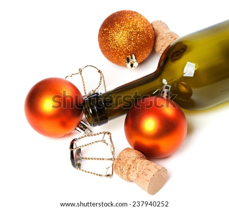 Empty bottle of wine, corks, muselets and Christmas decorations isolated on white background - stock photo