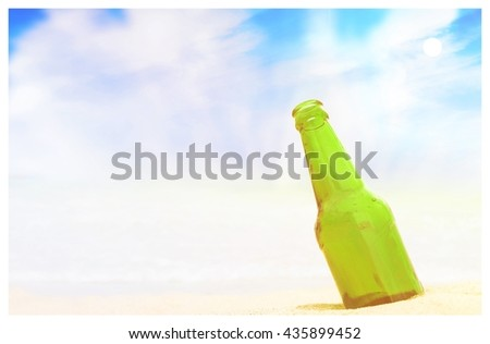 empty bottle summer on the sand and sky backgrounds