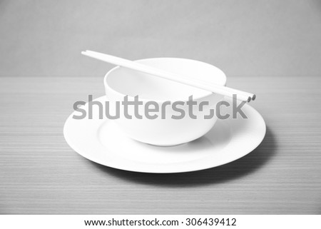 empty bowl with chopstick on wood table background black and white color tone style - stock photo