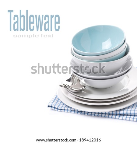 empty bowls, plates, forks and spoons, isolated on white - stock photo