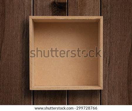 Empty box on wooden table.
