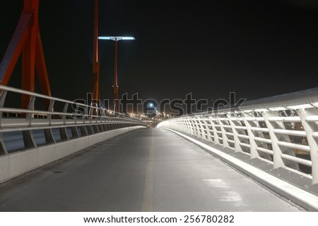 Empty bridge at night with lights photo - stock photo