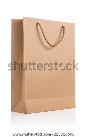 Empty brown paper bag isolated on white background. - stock photo