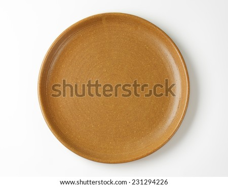 empty brown plate on white background - stock photo