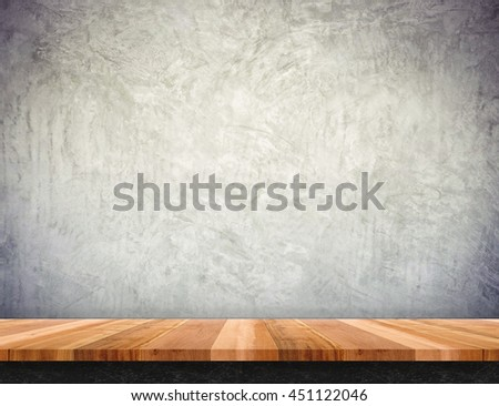 Empty brown wood table top with concrete wall,Mock up for display or montage of product.