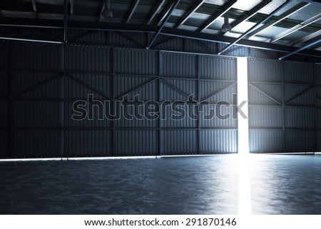Empty building hangar with the door cracked open with room for text or copy space. Photo realistic 3d interior render - stock photo