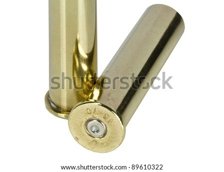 Empty bullet casings over white background - stock photo
