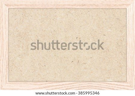 Empty bulletin board with a wooden frame. Wood board texture for design. Blank wood board background with copy space for text or image. - stock photo