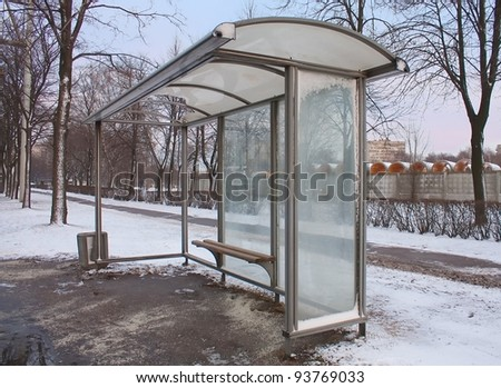 Empty Bus Stop in winter city - stock photo