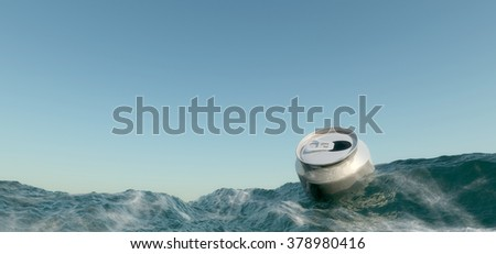 empty can floating in the ocean - stock photo