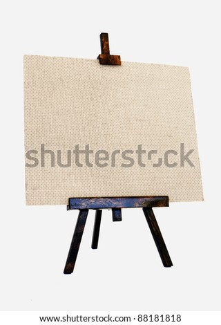 Empty canvas on a wooden tripod - stock photo