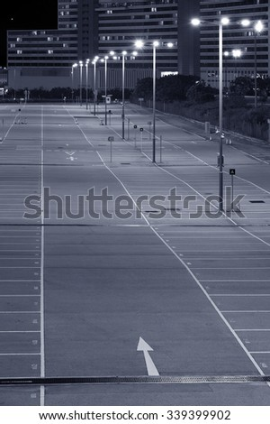 empty car park with city background - stock photo