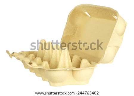 Empty cardboard egg carton shown on white background - stock photo