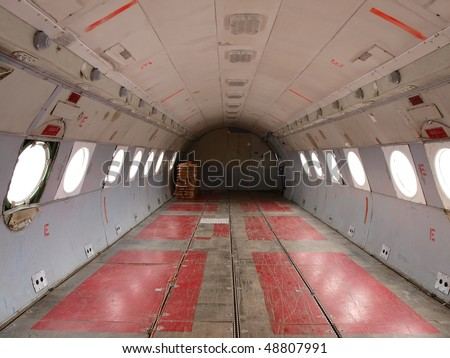 empty cargo hold of old plane - stock photo