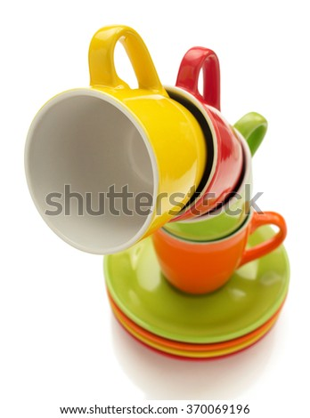 empty ceramic cup and saucer isolated on white background - stock photo