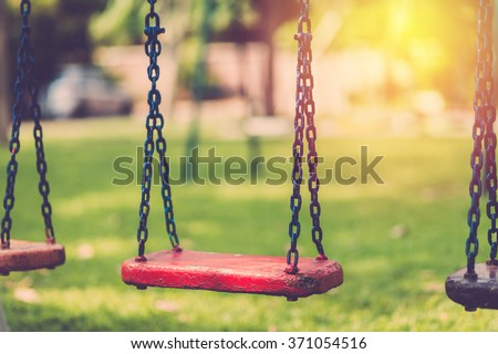 Empty chain swing in playground. Vintage filter - stock photo